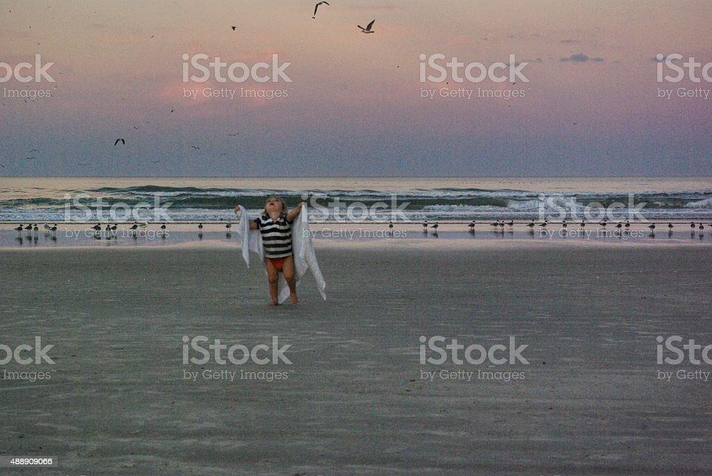 Child looks to the heavens stock photo