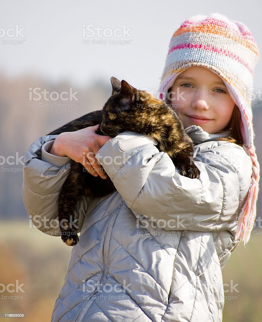 Child loves her Cat royalty-free stock photo