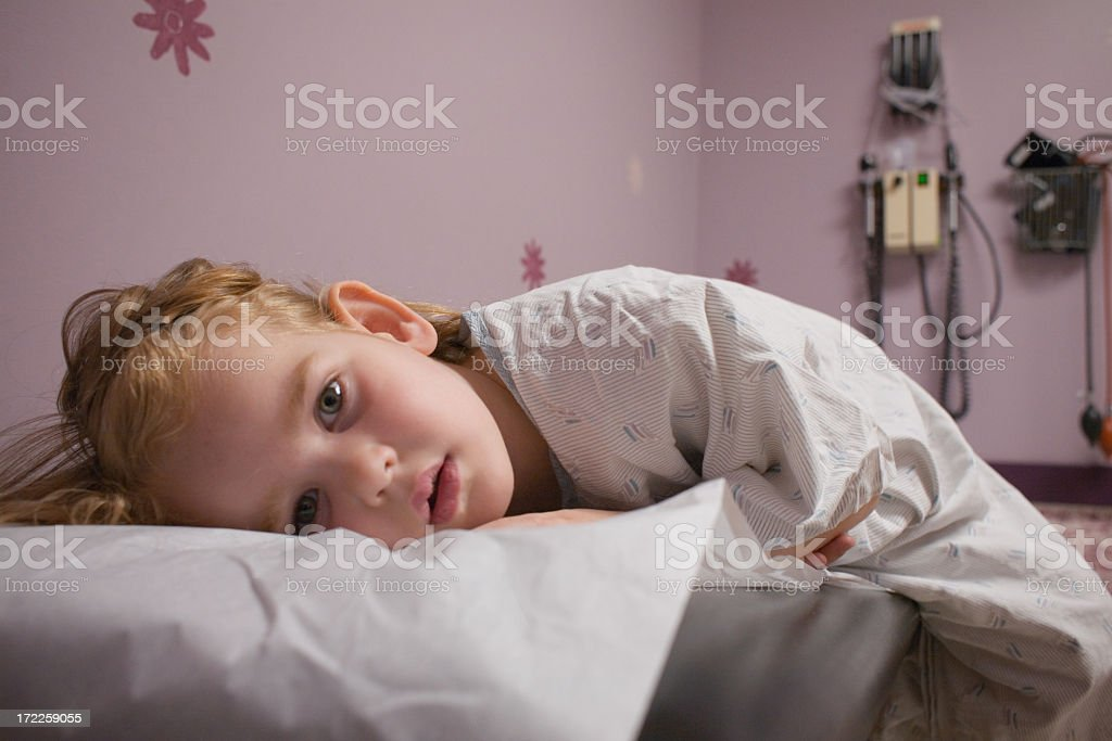 Child lying down at a doctor's office stock photo
