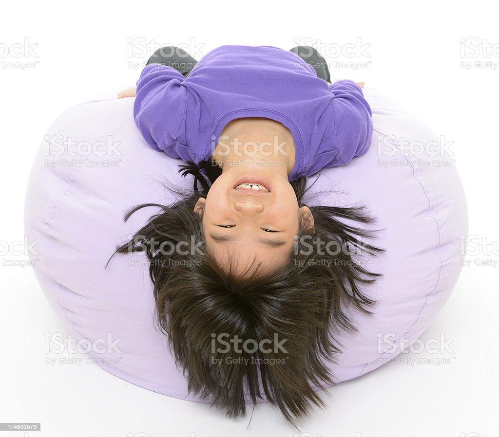 Child Lying Upside-Down on Beanbag royalty-free stock photo