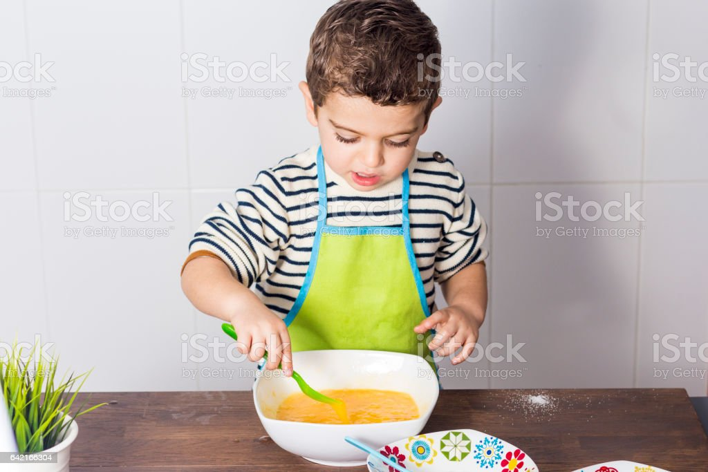 Child making a cake stock photo