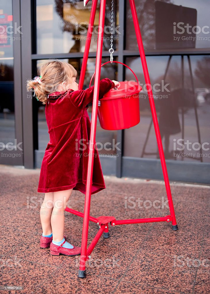 Child Making a Donation stock photo