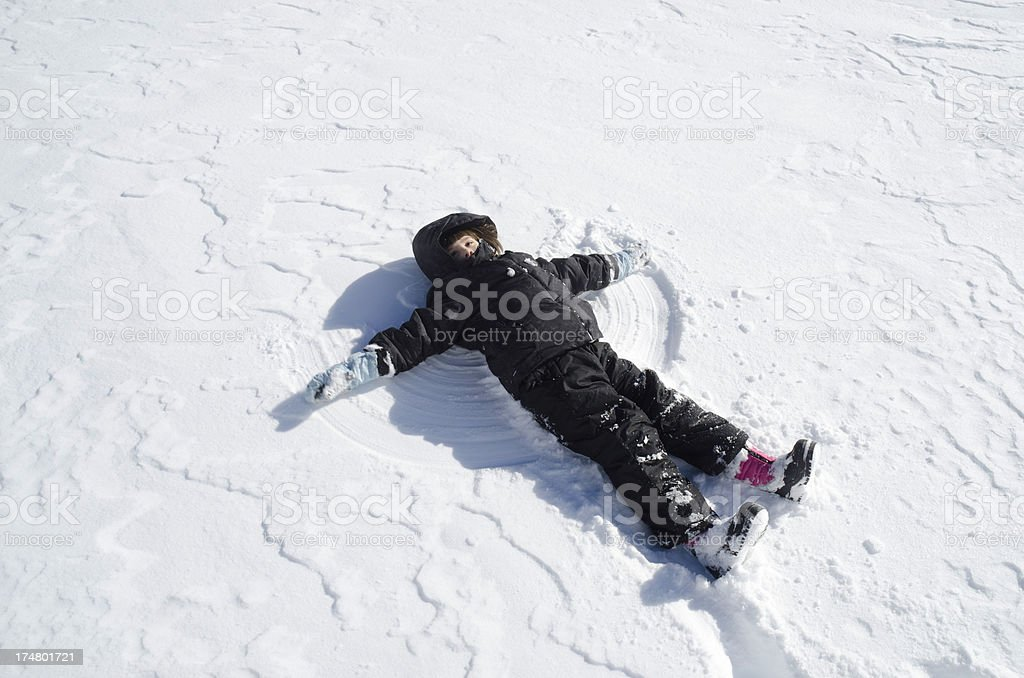 Child Making A Snow Angel royalty-free stock photo