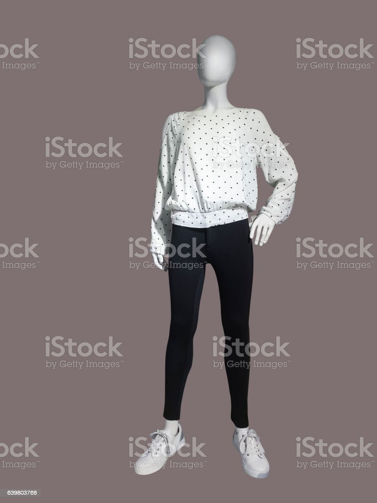 Child mannequin dressed in leggings and blouse stock photo