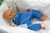 Child mannequin with connected sensors. Medical equipment