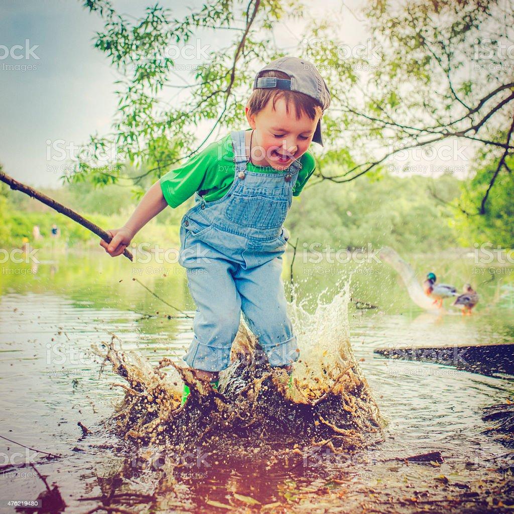 Child near lake stock photo