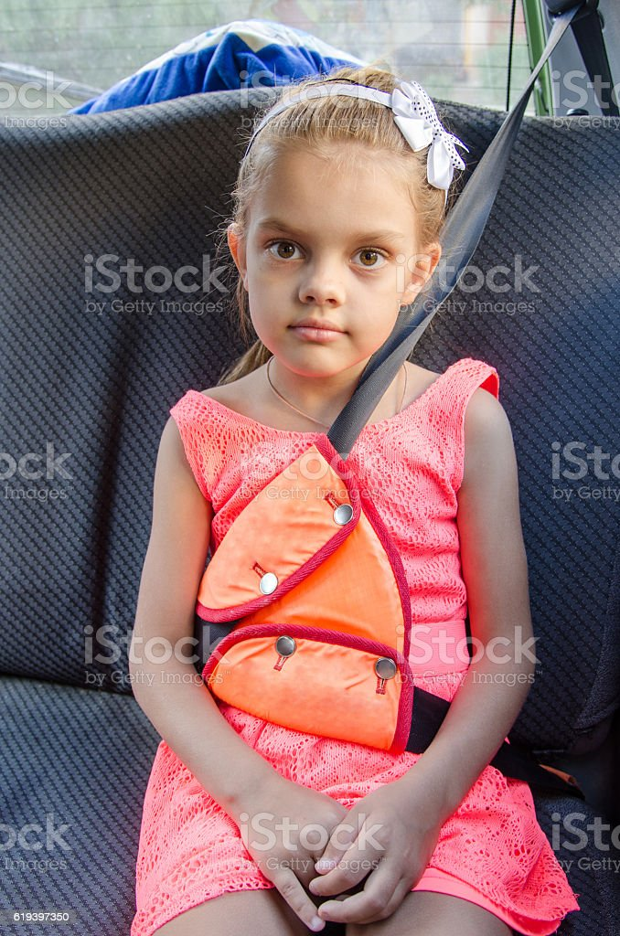 child of six sitting in the back seat of car stock photo