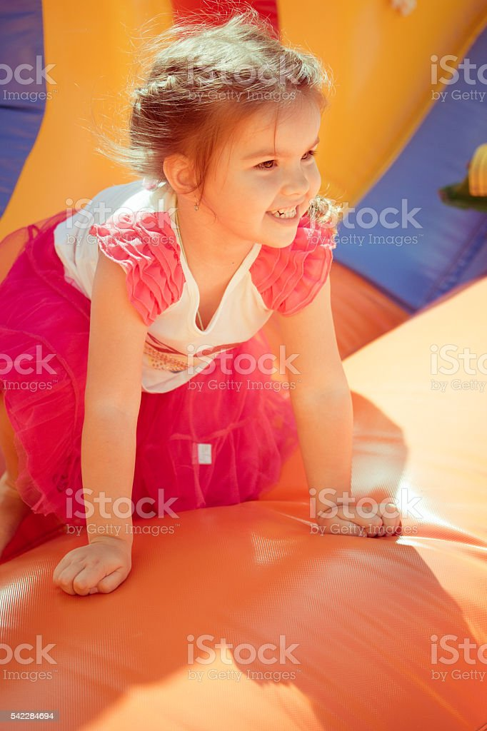 child on a colorful trampoline stock photo