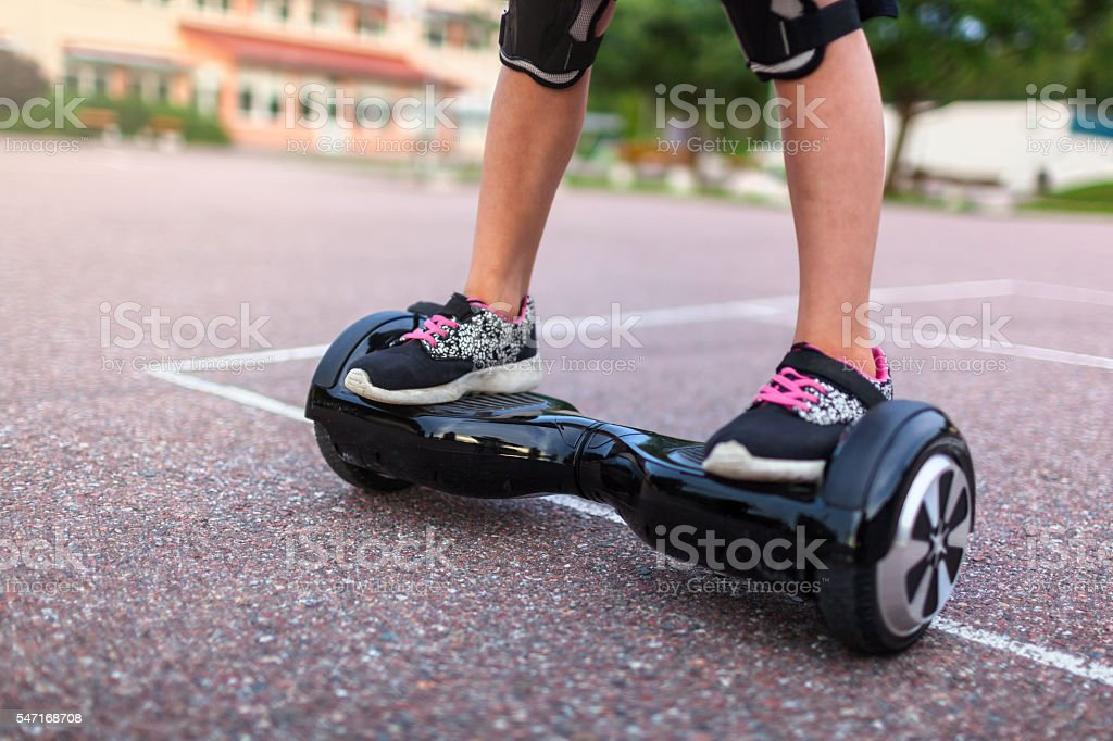 Child on a hoverboard stock photo