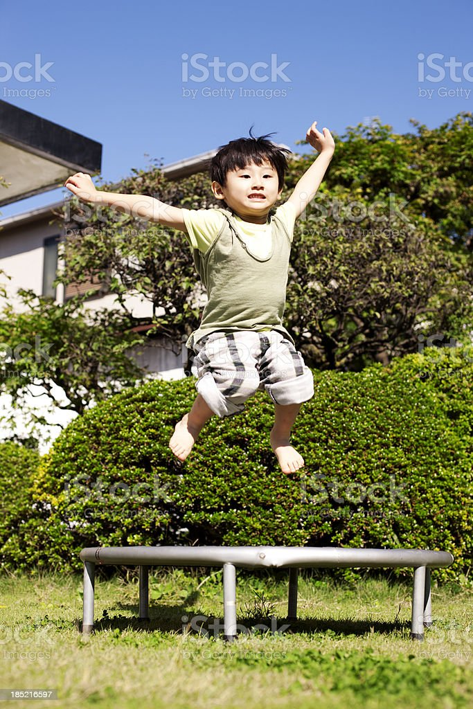 Child on a trampoline royalty-free stock photo
