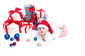 child on a white background with boxes of Christmas gifts