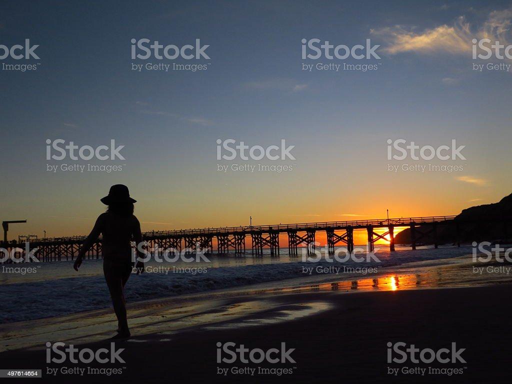 Child on beach at sunset stock photo