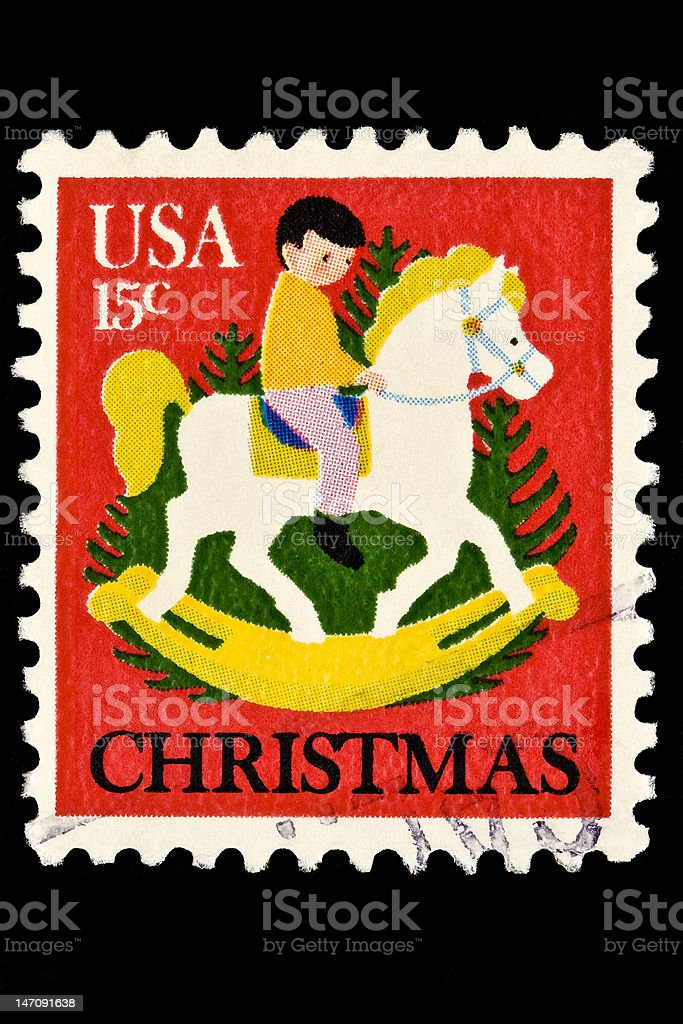 Child on Hobby Horse and Christmas Tree  Stamp royalty-free stock photo