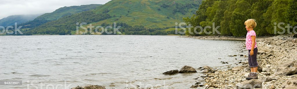 Child on lake shore royalty-free stock photo