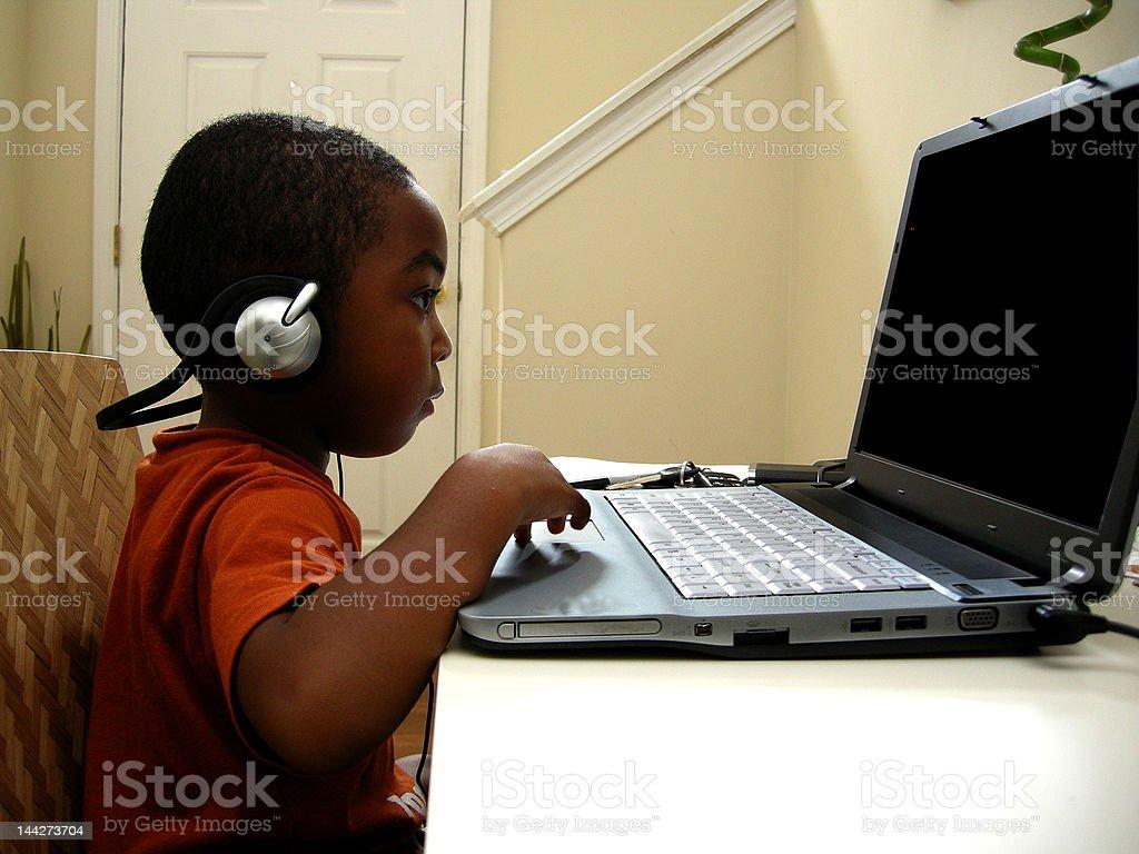 Child On Laptop Computer I royalty-free stock photo