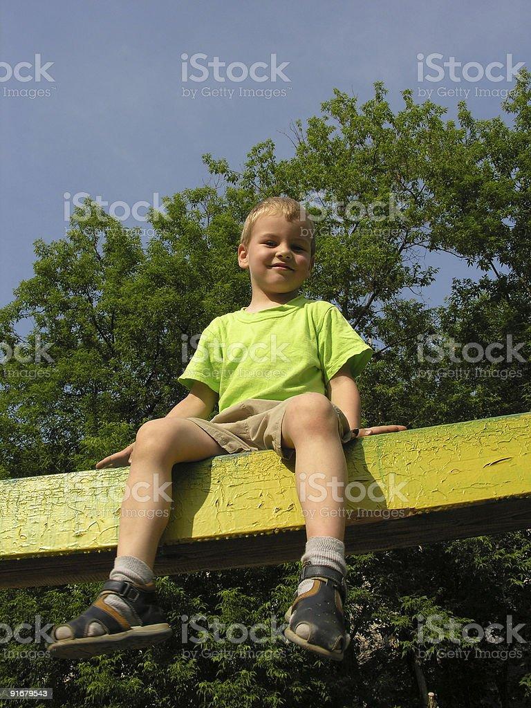 child on log stock photo