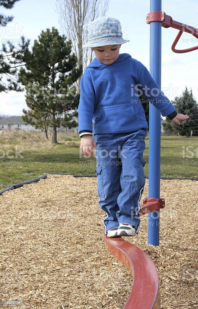 Child on Playground Balance Beam royalty-free stock photo