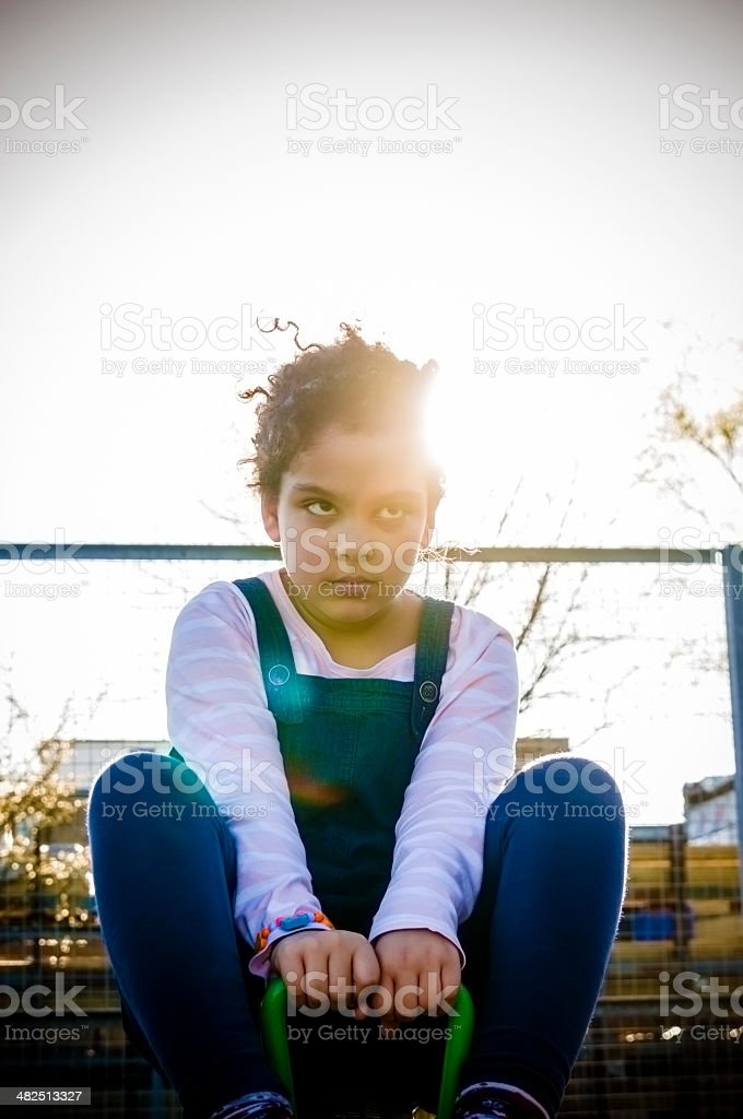 PEOPLE: Child (7-8) On Seesaw royalty-free stock photo