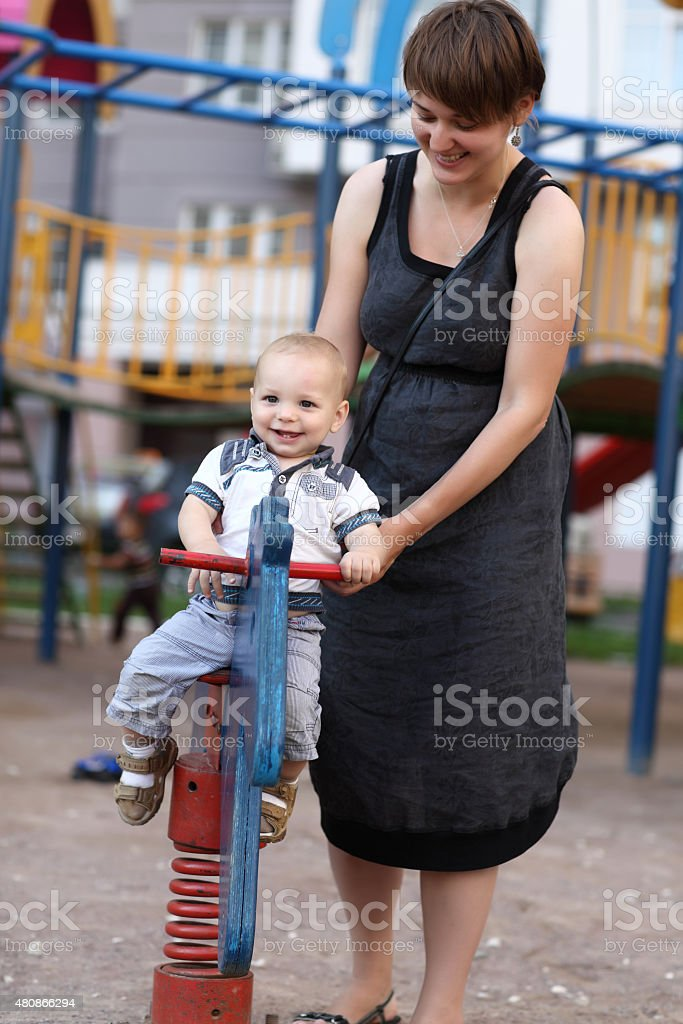 Child on spring toy horse stock photo
