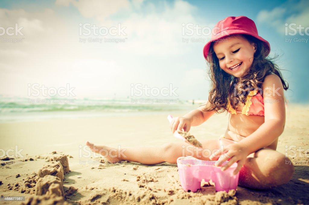 Child on the beach stock photo