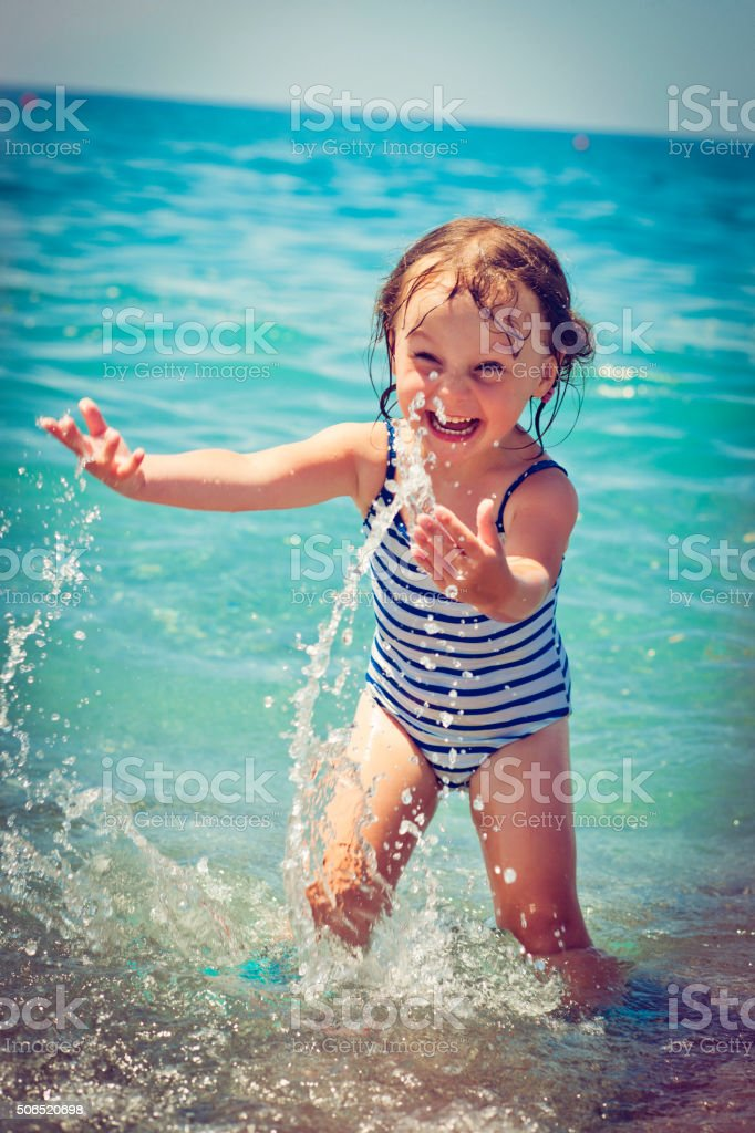 Child on the beach stock photo