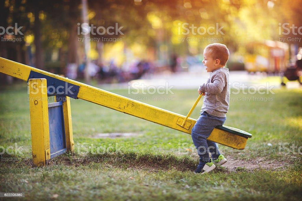 Child on the playground stock photo