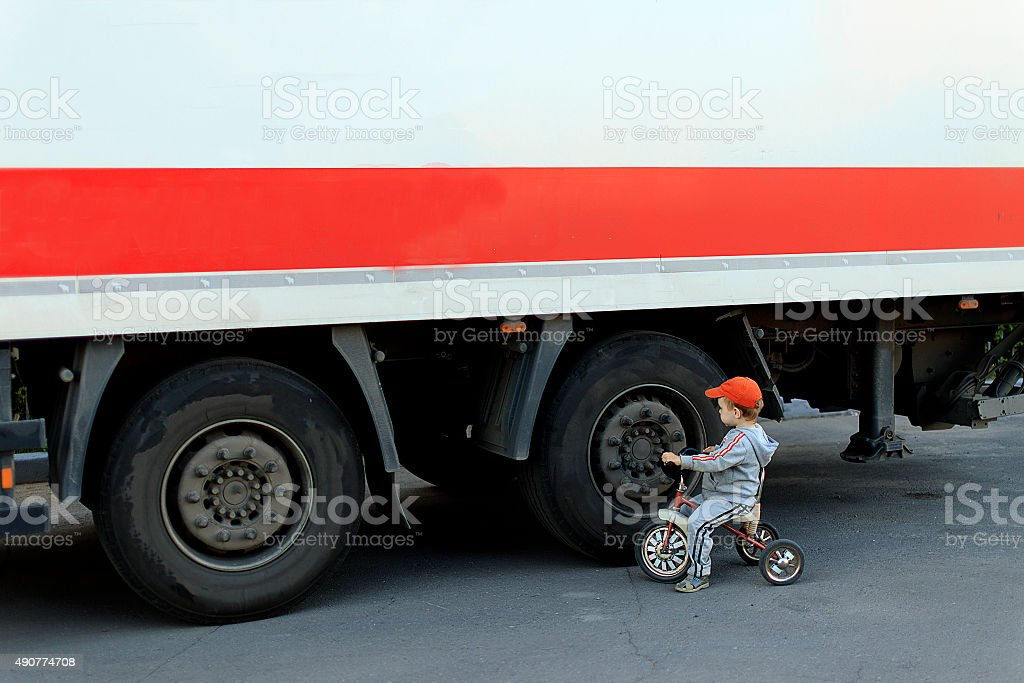 child on the roadway stock photo