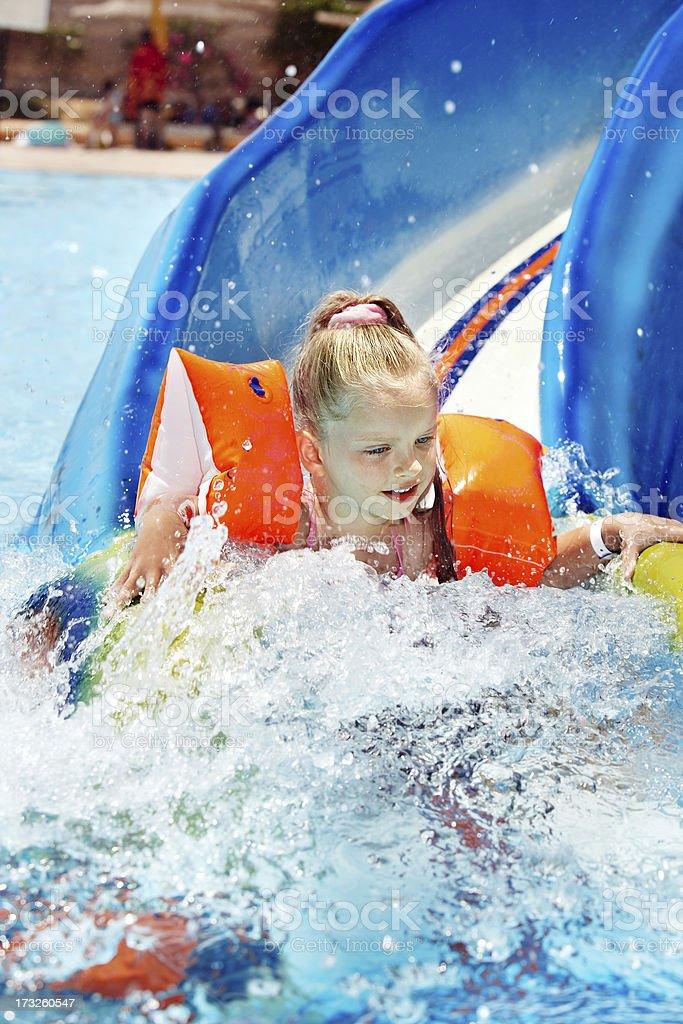 Child on water slide at aquapark. royalty-free stock photo