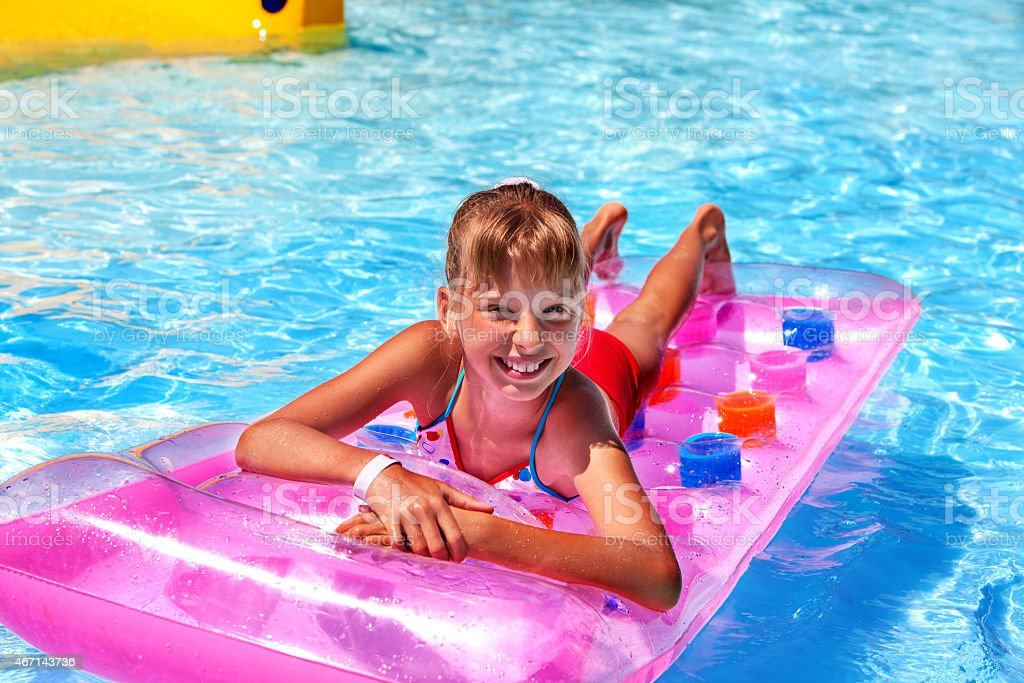 Child on water slide at aquapark stock photo