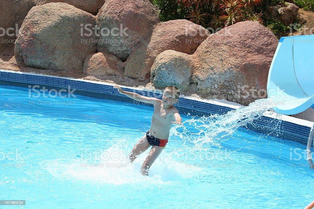 child on water slide stock photo