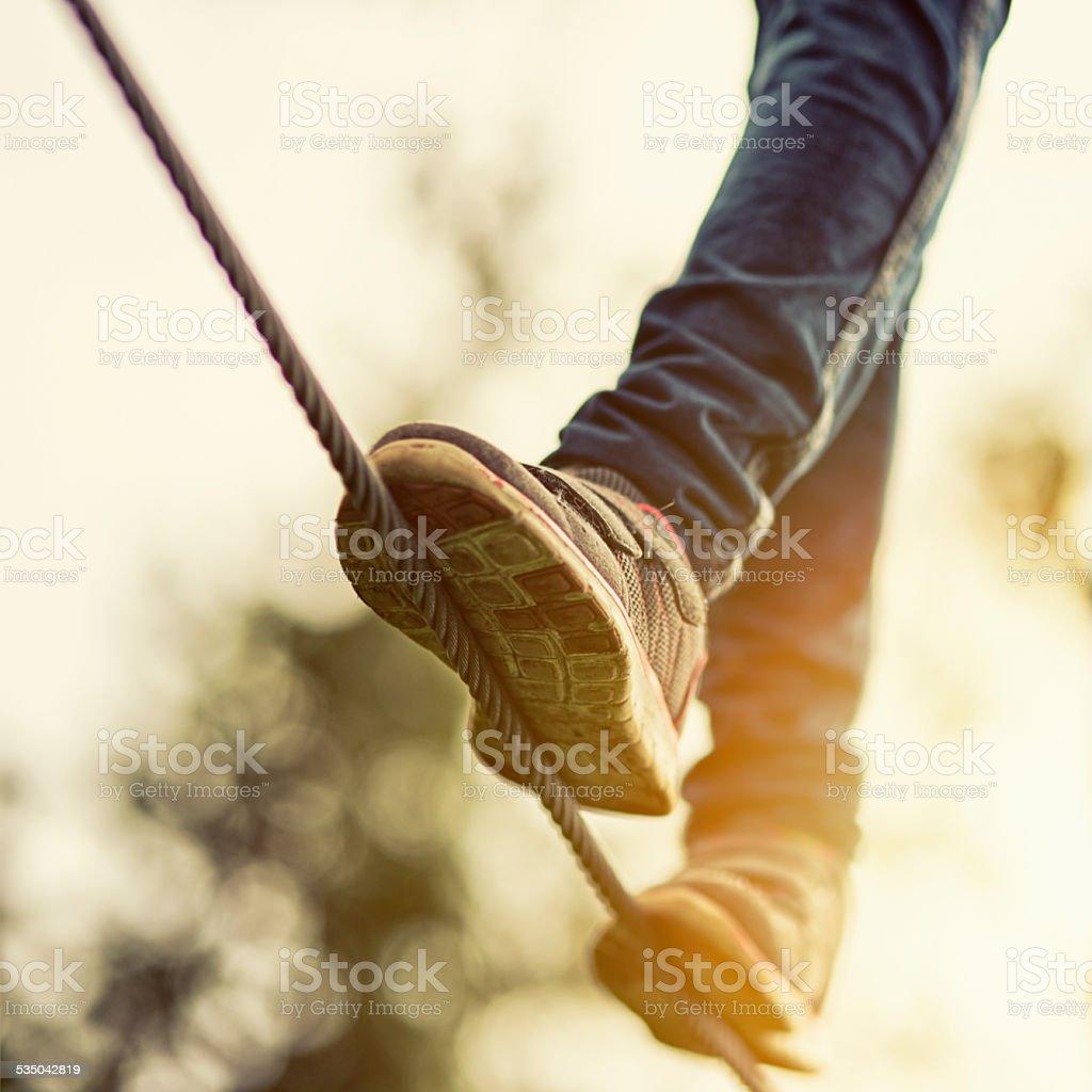 Child on zip line in adventure park stock photo