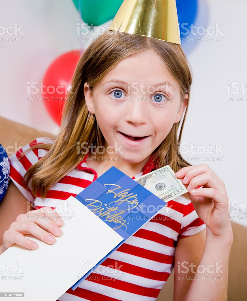 Child Opening a Birthday Card stock photo