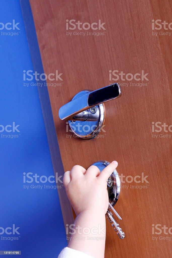 Child openning door stock photo