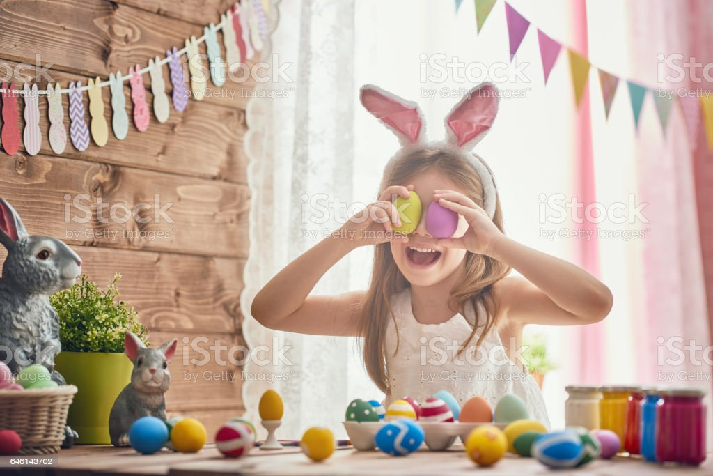 child painting eggs stock photo
