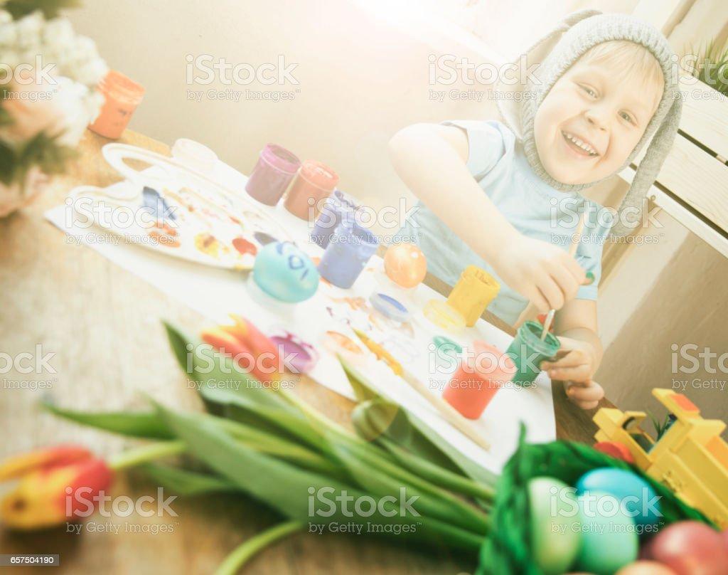 Child painting eggs stock photo