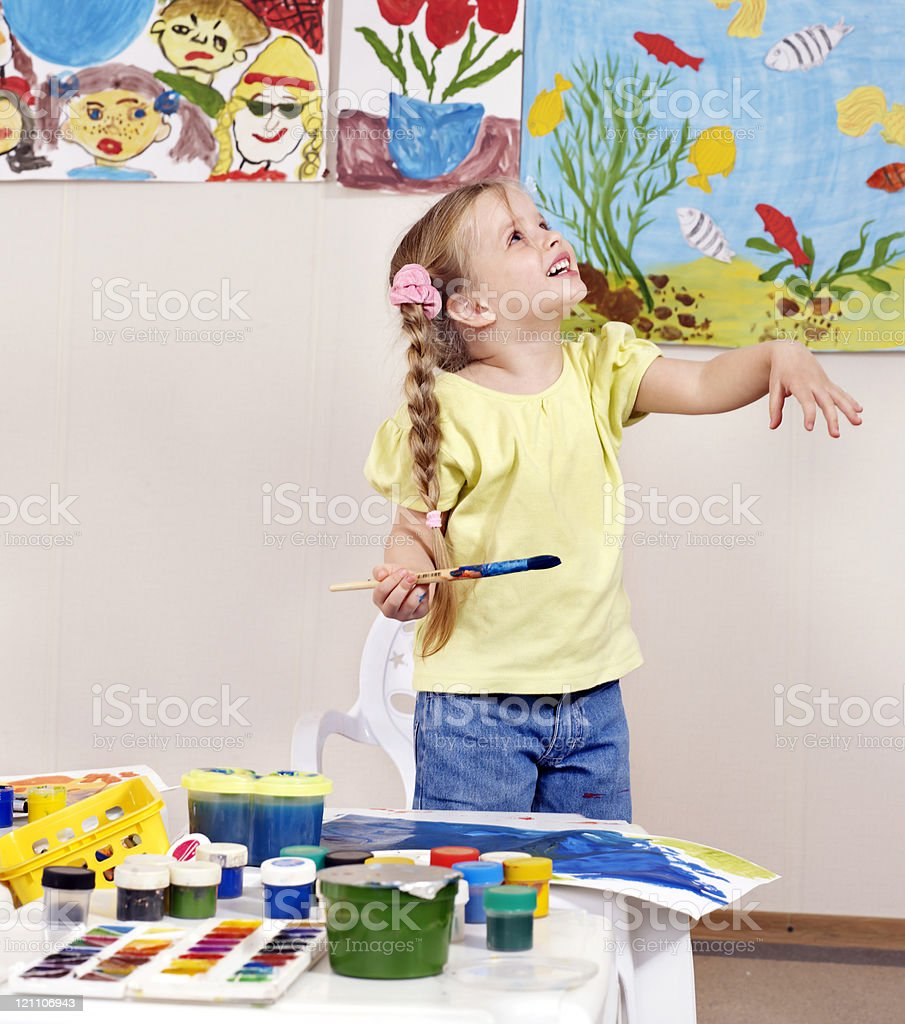 Child painting in preschool. royalty-free stock photo
