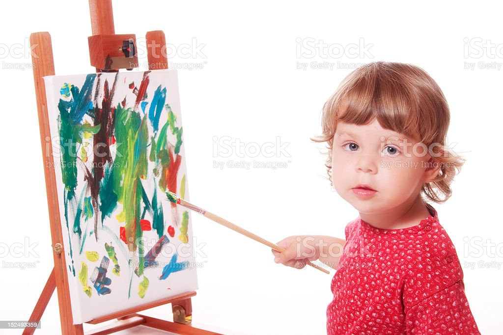 Child painting on easel stock photo