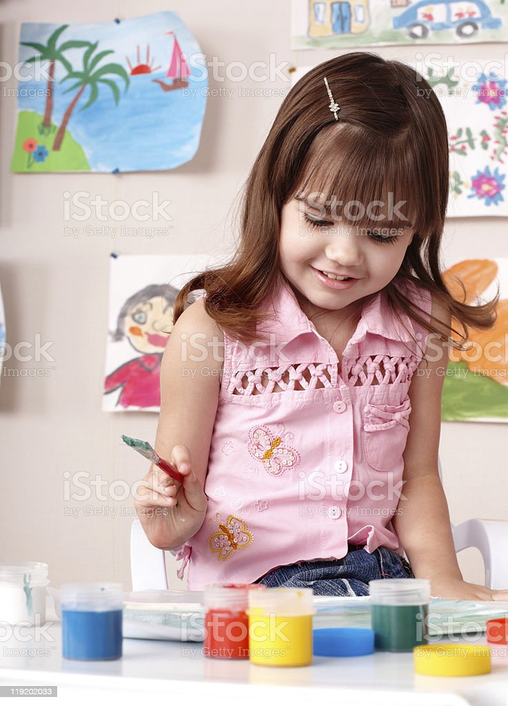 Child painting picture in preschool. royalty-free stock photo