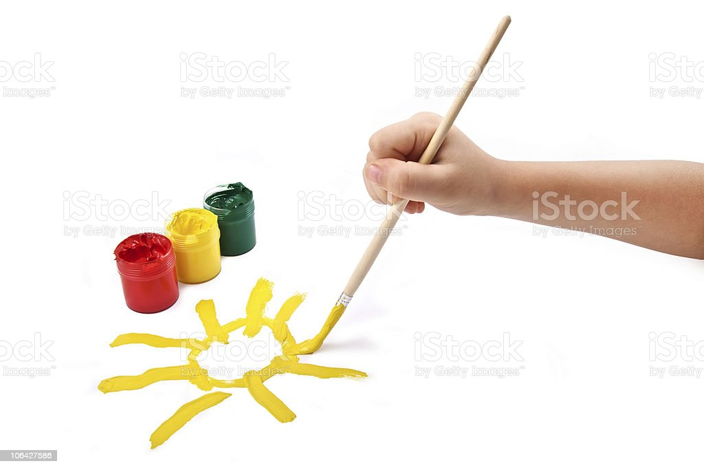 child paints a sun royalty-free stock photo