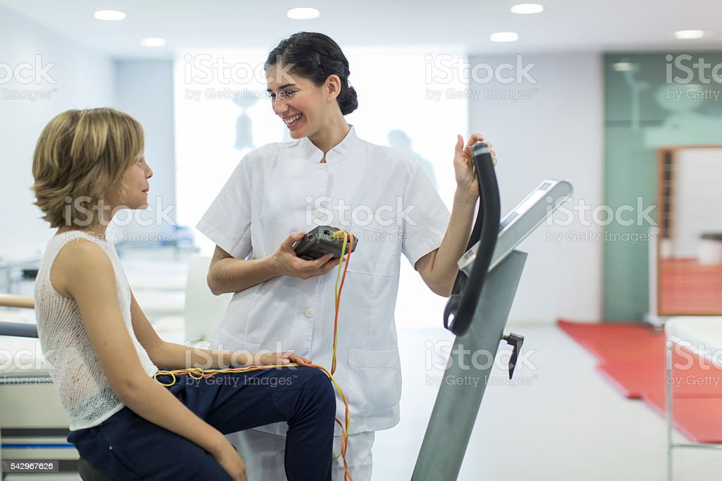 Child performing a stress test with electrodes stock photo