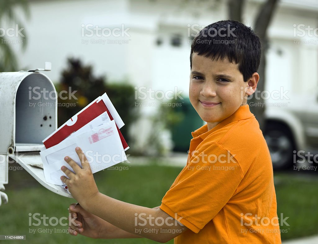 Child picking up the mail royalty-free stock photo