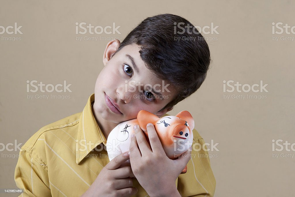 Child piggy bank with your money royalty-free stock photo