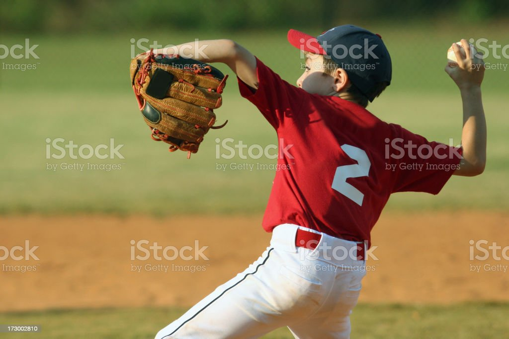 Child pitching for a baseball game royalty-free stock photo