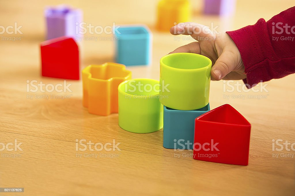 child play with toy blocks stock photo