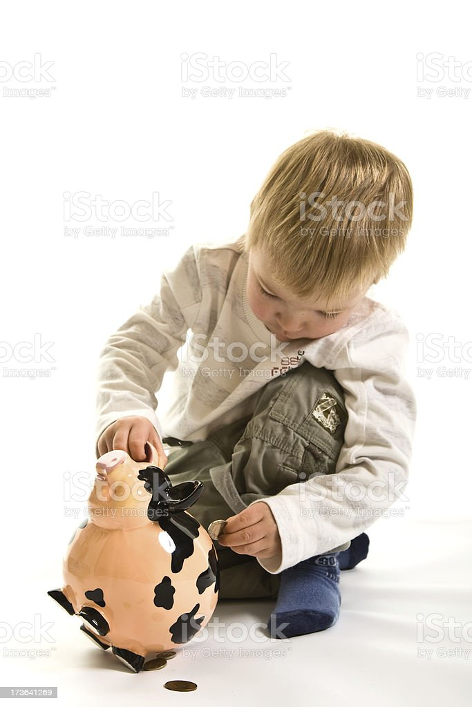 Child playing at Banking with coins and piggy bank royalty-free stock photo