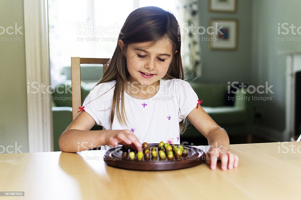 Child playing boardgame stock photo