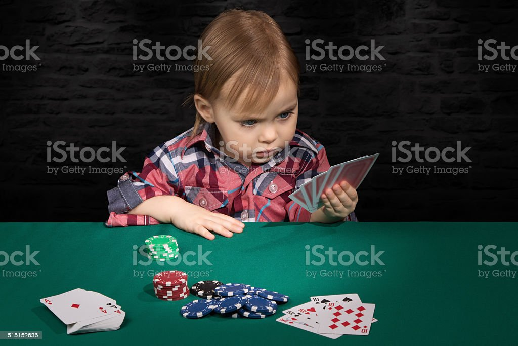 Child playing cards stock photo