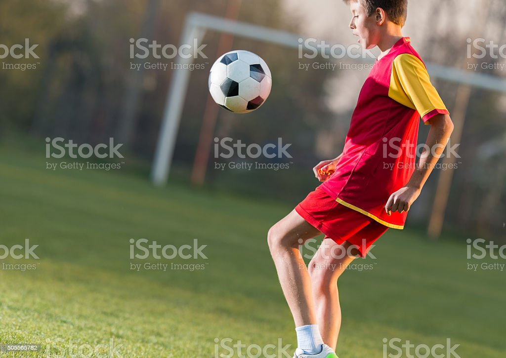 Child playing football stock photo
