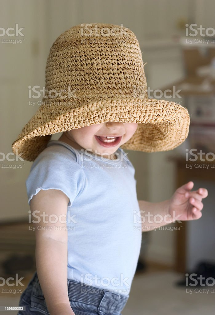 child playing hide and seek royalty-free stock photo