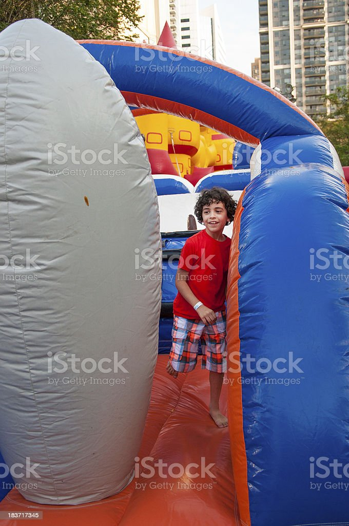 Child Playing in an Inflatable Playground stock photo